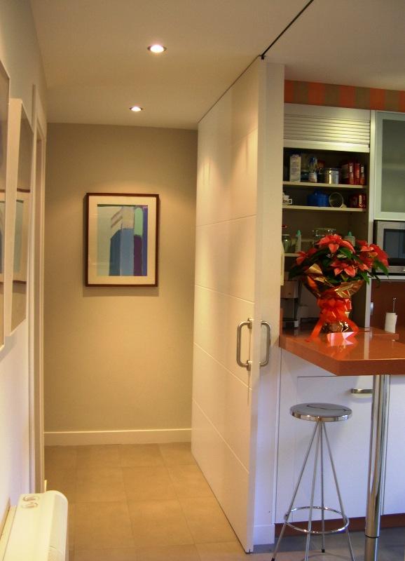 Grandes puertas correderas como incorporar espacios sin - Puertas correderas de cocina ...
