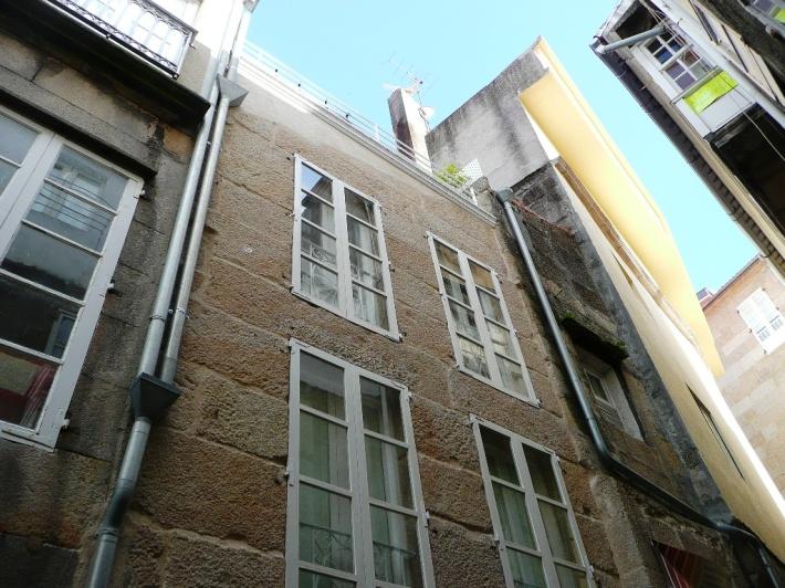 fachada reparada sillería granito